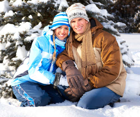Young  happy smiling couple in love. Winter  Imagens