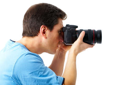 Handsome man with photo camera. Isolated over white background Stock Photo - 4108701