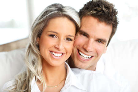 settler: Young love couple smiling in the comfortable apartment  Stock Photo