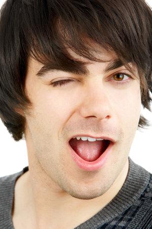 winking: Handsome uomo occhiolino. Isolato su sfondo bianco