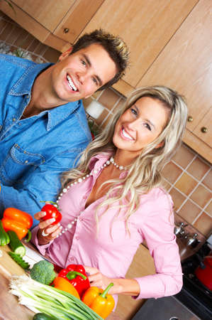Young love couple cooking in the kitchen  photo