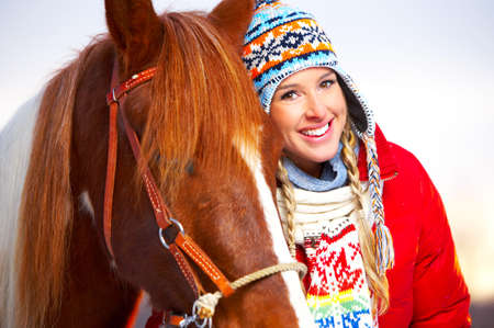 horse laugh: Young  happy smiling woman with horse. Winter sport