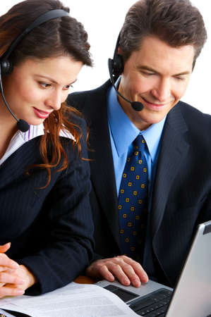teleconference: Smiling  business people  with headsets. Over white background   Stock Photo