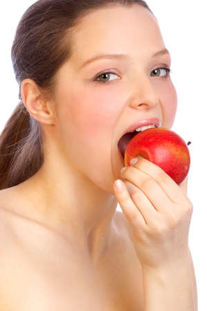 Beautiful young woman eating the red apple. 