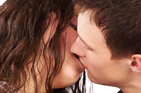 love kissing: Young couple in love kissing.  Over white background    Stock Photo