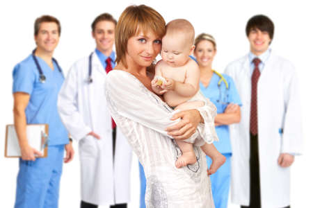 pediatrics: mother with baby, medical doctors, nurses. Over white background