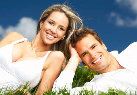 Young love couple smiling under blue sky Stock Photo - 4137019