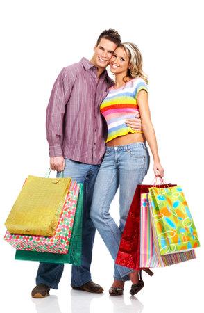 Shopping  couple  smiling. Isolated over white background Stock Photo - 4184382