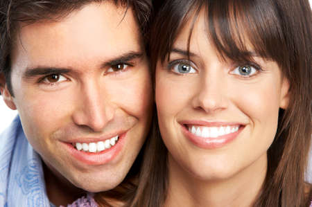 smiling teeth: Happy smiling couple in love. Over white background