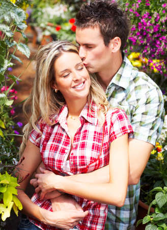 lovers embracing: Young happy love couple smiling in the garden