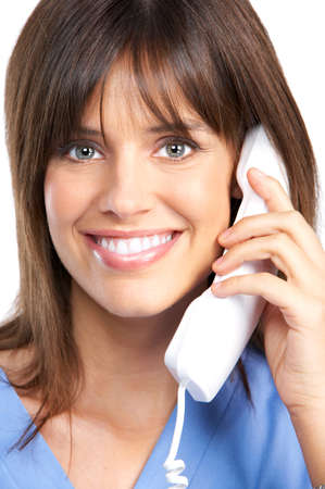 woman on phone: Smiling medical nurse with telephone. Isolated over white background  Stock Photo