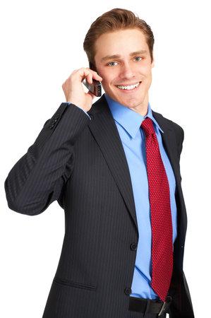 calling: joven hombre de negocios llamando por tel�fono celular. M�s de blanco