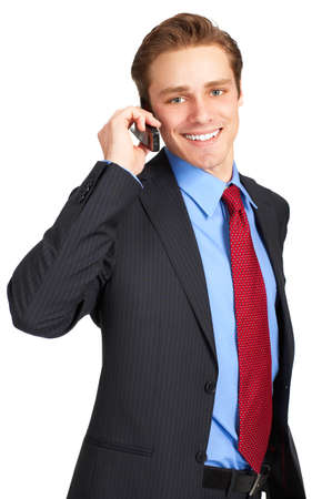 calling: young businessman calling by cellular phone. Over white