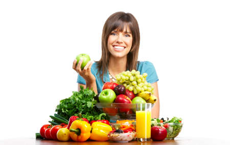 Young smiling woman  with fruits and vegetables. Over white background Stock Photo - 4278223
