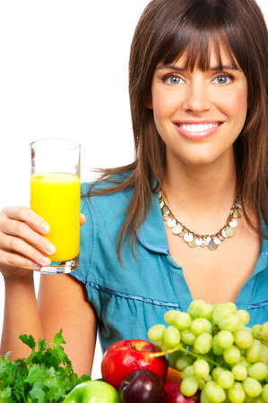Young smiling woman  with juice, fruits and vegetables. Over white background  photo