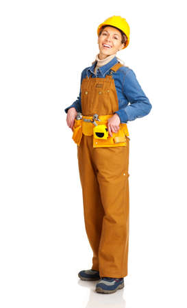Young builder woman in yellow uniform. Isolated over white background