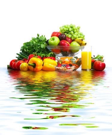Vegetables, fruits and water. Apple, carrot, plum, sweet pepper Standard-Bild