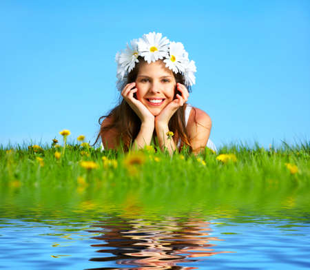 Beautiful woman with  flower diadem under blue sky  photo