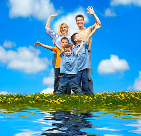 Family under blue sky. Father, mother and sons in the park Stock Photo - 4347402