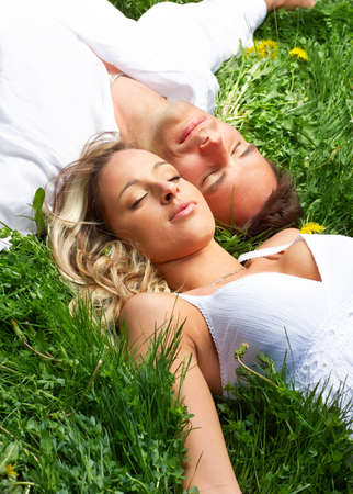 Young love couple sleeping on green grass Stock Photo - 4347395