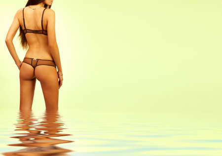breech: Pretty sexy young woman in water. Over green background