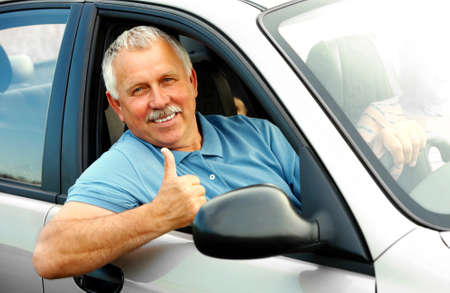Smiling happy elderly man  in the new car Stock Photo - 4365214