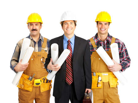perforate: Builder people  in yellow uniform. Isolated over white background  Stock Photo