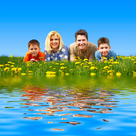 river: Happy family. Father, mother and sons in the park  Stock Photo