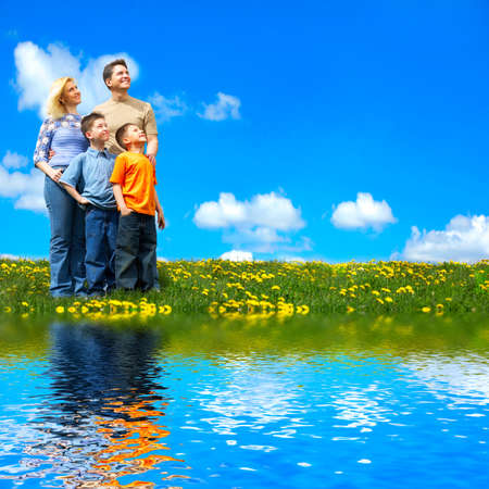 river: Family and blue sky. Father, mother and sons near the lake