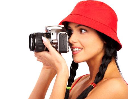 foto: Jonge mooie glimlachende vrouw het bezit is van een fotocamera.