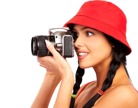 Young beautiful smiling woman holding a photo camera.