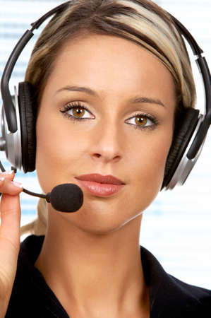 Pretty business woman with headset. Over white background   photo