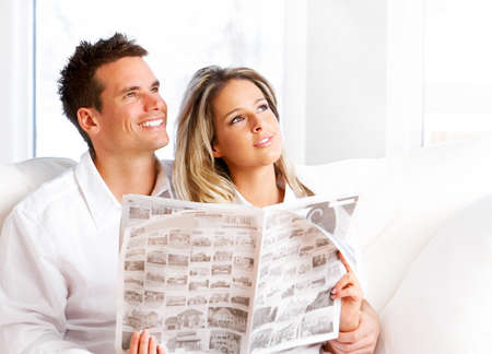 adult magazines: Young love couple reading magazine  in the comfortable apartment