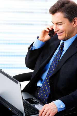 businessman  working with laptop and calling by cellular Stock Photo - 4420628