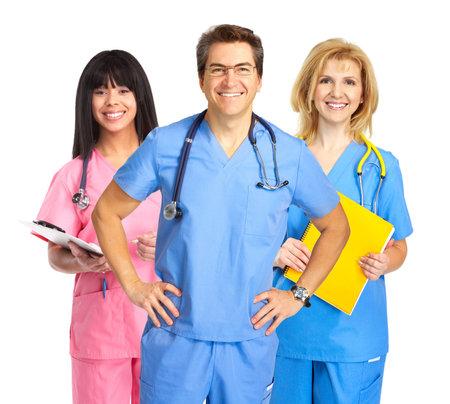 medical doctors: Smiling medical nurses with stethoscopes. Isolated over white background