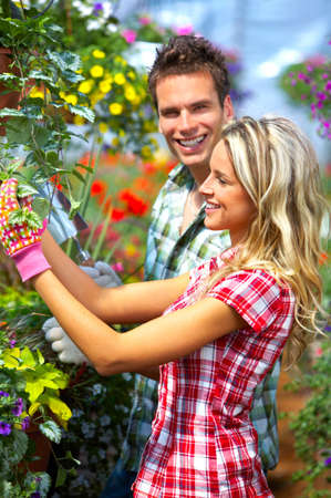 Young smiling people florists working in the garden Stock Photo - 4487537