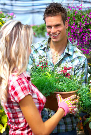 Young smiling people florists working in the garden Stock Photo - 4487485