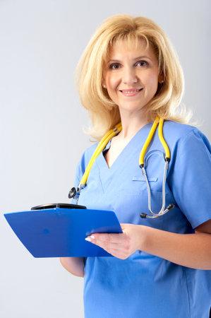 Smiling medical nurse with stethoscope. Over white background