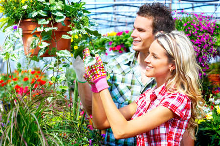 Young smiling people florists working in the garden Stock Photo - 4487586