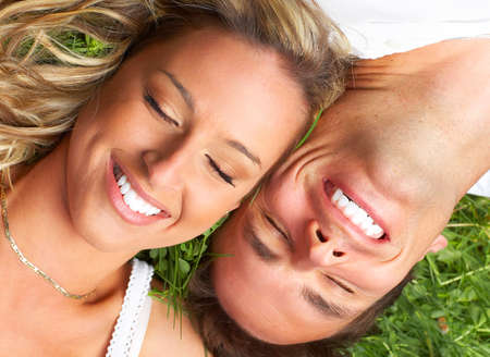 Young love couple sleeping on the green grass 