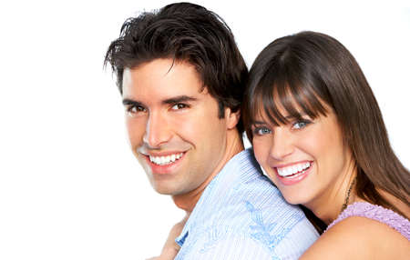 tooth whitening: Happy smiling couple in love. Over white background