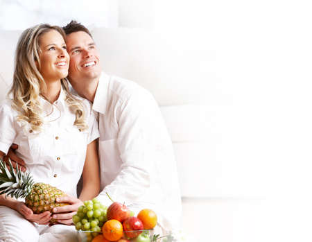 Young love couple with fruits in the comfortable apartment Stock Photo - 4621767