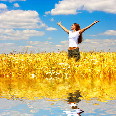 Happy young woman in the yellow  field  photo