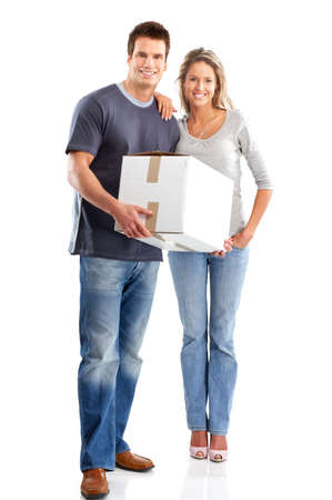 parsel: Young smiling couple holding a box. Isolated over white background