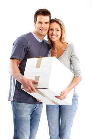 Young smiling couple holding a box. Isolated over white background