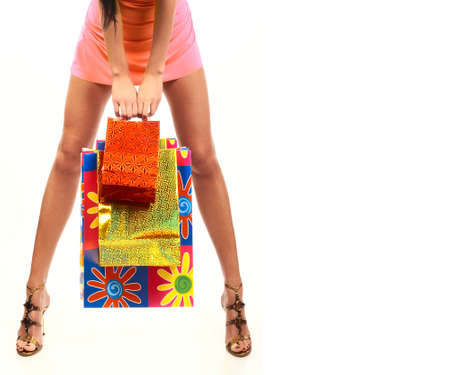 Shopping woman. Isolated over white background  photo