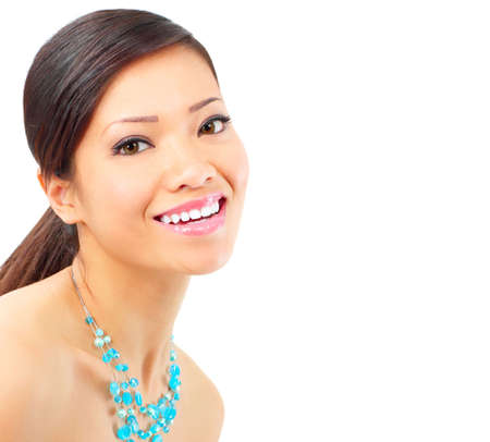 Beautiful young smiling woman. Isolated over white  background  photo