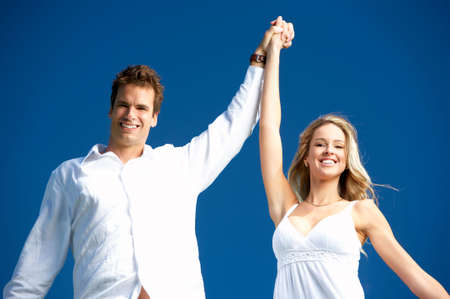 Young love couple smiling under blue sky Stock Photo - 4752132