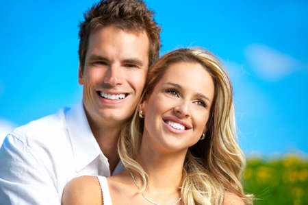 honeymoon couple: Young love couple smiling under blue sky  Stock Photo