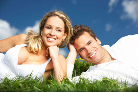 parc: Young love couple smiling under blue sky  Stock Photo